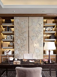 chinoiserie wallpaper sliding panels over bookshelves