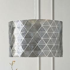 Faceted Capiz Drum Pendant; I love this for the dining room...brings the metal/charcoal gray and graphic nature into the space.