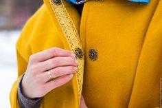 Купить или заказать Пальто-кокон 'Цвет шафрана'' в интернет-магазине на Ярмарке Мастеров. Лёгкое пальто чуть зауженного к низу модного силуэта кокон, яркого жизнерадостного цвета шафрана. Удобные большие карманы, отделка кружевом и красивые кнопочки. Не менее симпатично и с изнанки, выложила волокнами вискозы сочетающихся цветов. Длину рукава можно регулировать с помощью отворачивающегося манжета. Выполнено в смешанной технике валяния и шитья.…
