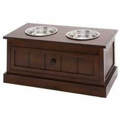 With a bottom drawer for storage, this timeless wood pet diner features 2 steel bowls and a paneled design for classic appeal. Product: Pet dinerConstruction Material: Wood and steelColor: Chocolate brownFeatures: Bowls includedDimensions: H x W x D Elevated Dog Feeder, Dog Food Storage, Pet Feeder, Wood Steel, Dog Feeding, Pet Bowls, Joss And Main, Dog Life