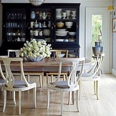 I've long adored this Sag harbor home designed by Ruby Beets, photo by Don Freeman - Love the Gustavian chairs!