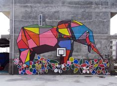 Origami-Style Street Art Brings Color to Nepal - Japan-based American artist Daas is one of 60 artists who came from all over the world to give Nepal an artistic facelift. They were invited to paint 75 site-specific murals on Nepal's walls as part of an art project called Kolor Kathmandu.