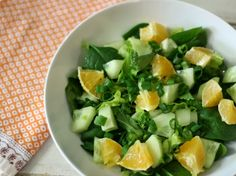 Simply Orange Side Salad - A light, refreshing, sweet and savory side salad made with cucumbers, spinach, scallions and fresh oranges and topped with a simple orange flavored dressing.