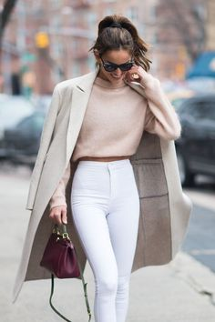 How to wear white jeans in the winter by styling them with peach and nude tones
