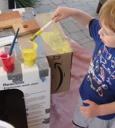 Connect boxes and paint. Keeps them busy and creative. We're building a home-made spaceship!
