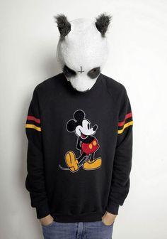 Aww he likes Mickey cause he looks like the panda bear ahh so cute