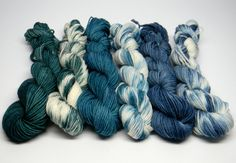Put to Sea - Set of Six Jig Monkey Mini Skeins - 20g/93 yards each - 120g/558 yards total Seafaring colors - teal, blue, green tones of the sea with white caps. Colors are tonal and related - designed to work together beautifully. Jig Monkey Yarn Base - 75% Superwash Merino/25% Nylon 20g/93 yards/mini skein Soft, elastic and durable; a gorgeous sock yarn. Hand Wash ~ Air Dry Want to add a little stripe to your project? Working a sock yarn blanket? Making a master piece of mini's? This is the…