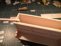 Miniature Piano workshop. Step no.15 . Apply some paste on the edge of the box...
