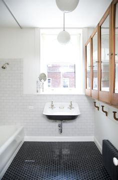 "If  you're looking for a simple, yet modern bathroom design, consider throwing classic 3"" x 6"" white polished subway tile on the walls (a lighter colour will always open up a space and give the illusion of more light) with a dark 1"" Hexagon Mosaic (Blue Stone marble) on the floor providing an elegant contrast."