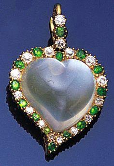 A late Victorian moonstone, diamond and demantoid garnet pendant, circa 1890