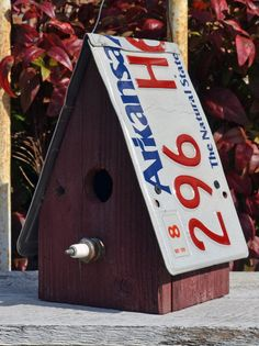 Birdhouse made out of old license plates.  Maybe we could do this with the old plates we just took off the Jeep.