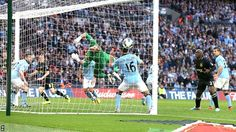 Ben Watson scored with a dramatic 91st-minute header as Wigan shocked Manchester City to win the FA Cup. The substitute rose to meet Shaun Maloney's corner and stun the 2011-12 Premier League champions at a rain-soaked Wembley Stadium.