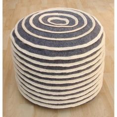 Enhance your decor with this stylish modern pouf made of this soft felt.