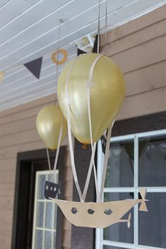 Easy and very cheap steampunk party decorations: cardboard airships with attached gold balloon!