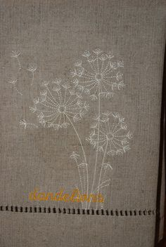 Oatmeal colored hemstitched towel with dandelions.