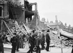 The Prime Minister Winston Churchill visits bombed out buildings in the East End of London on 8 September 1940.