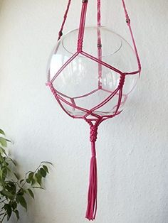 """Indoor macrame plant hanger. Beaded macrame plant hanger is made from 2mm durable Polypropylene braided cord. The color of cord on the photo is dark pink with dark green beads. It is 37"""" (94cm) long from the top loop to the end of the basket. The red pot on the photo is 8"""" wide on the top, the glass bowl is 10'' wide. Recommended pot size is from 6"""" to 11"""" in diameter. The length of the hanger will vary depending on pot size you use. Decorative pot is used for demonstration and it is not..."""