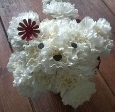 Puppy in a pot made from carnations