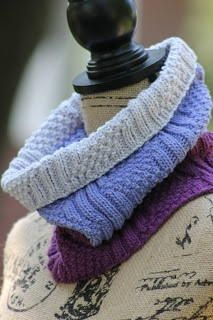 Lilac Dream Knit Cowl - The Lilac Dream Knit Cowl will quickly become one of your favorite free knitting patterns. This gorgeous knit cowl pattern in composed of several different types of knitting stitches that create an intricate and exquisite look without having to deal with lace knitting. This ombre cowl is made by knitting in the round and is a perfect stashbuster pattern for those scraps of yarn you always knew you'd find the right project for. Smile with satisfaction when you finish.