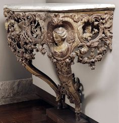 elaborate carved wood...image of fairy...marble top...console table, France (c. 1720)