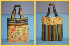 Avondje achter de naaimachine. Cadeautje voor de juf. De kleuters versierde zelf de stof. De tas is omkeerbaar.
