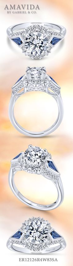 Gabriel - 18k White Gold Round 3 Stones halo engagement Ring. Ornate hand engraving with mil-grain detailing along the shank, with two sapphires accenting a beautiful halo center stone, creating a Victorian inspired platinum engagement ring fit for a queen.