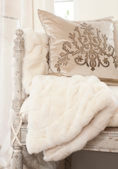 Silk pillow and faux fur throw...elegant & inviting