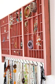 jewelry display case made from printblock storage.  Love the hooks.