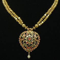Antique, early 20th century necklace from Rajasthan, India. This beautiful, unique piece, is made of 22K yellow gold and studded with diamonds, emerald, rubies and exotic pearls.
