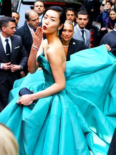 Liu Wen (wearing Zac Posen) on her way to the 2014 Met Gala photographed by Phil Oh for Vogue.com