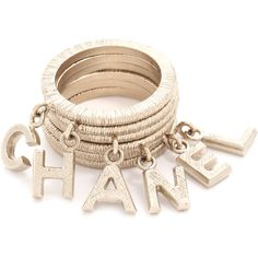 What Goes Around Comes Around Chanel Dangling Letters Ring Set... found on Polyvore featuring jewelry, rings, gold, initial jewelry, initial ring, stackable initial rings, letter charms and dangle charm rings