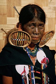 Myanmar/Burma - Chin lady with traditional facial tattoos and huge ear plugs, by Rudi Roels via flickr
