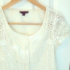 Eyelet lace top EUC Lovely woven boho top from American Eagle Outfitters in a natural white ivory color. Beautiful details like crochet lace, eyelet embroidery, and a scalloped hem. 100% cotton. Worn 2 to 3 times, no flaws, excellent condition. Please ask any questions you may have! American Eagle Outfitters Tops