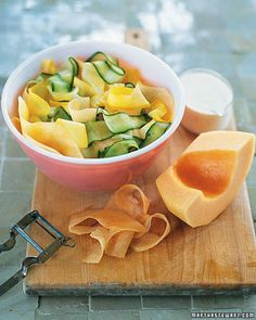 Cucumber, Cantaloupe, and Squash Salad | Martha Stewart Living - Use a vegetable peeler or a mandoline to slice thin ribbons of cantaloupe, cucumber, and yellow summer squash for this refreshing and colorful salad. Just before serving, drizzle with yogurt-lime dressing.