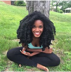 @Drphoenyx  | This is all of her God given hair. Long afro hair. long natural hair. long kinky hair. natural hair. afro hair. kinky hair. big hair. soft and fluffy hair. poofy hair. black woman with long hair.
