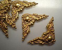 6 small brass ornate corner brackets, No. 1