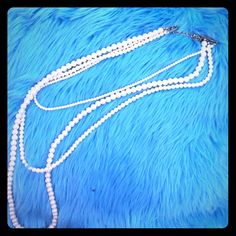 BOGO 3 Strand Pearl Necklace Single necklace with 3 strands of faux pearls in varying sizes, gold clasp. All jewelry is buy one get one free (second item must be same or lower price), just ask me to make your bundle! Forever 21 Jewelry Necklaces