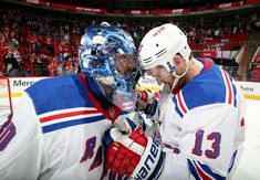 RALEIGH, NC - MARCH 31: Henrik Lundqvist #30 and Kevin Hayes #13 of the New York Rangers celebrate their team's 2-1 victory over the Carolina Hurricanes following an NHL game on March 31, 2018 at PNC Arena in Raleigh, North Carolina. (Photo by Gregg Forwerck/NHLI via Getty Images)