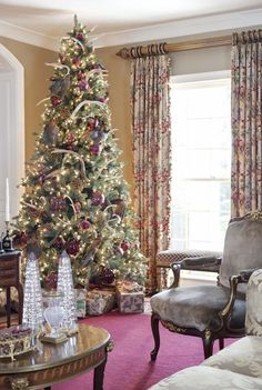 Christmas Tree Decorating Ideas for 2013 : / Very rich and tall Christmas tree wrapped in oversized ornaments. Deer antlers in the tree? I love it.