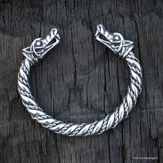 The terminals of this heavy and chunky Viking bracelet are decorated with stylised wolf heads.   The wolf heads are inspired by a mythical Viking wolf Fenrir. According to Norse mythology this fierce beast is destined to fight Odin during Ragnarök.
