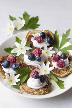 Banana pancakes with wipped coconut cream and fresh berries.