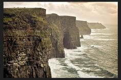 Cliffs of Moher, County Clare, Ireland - The most surreal and enchanting place I've ever been. If you are going to visit, make sure its a clear day with no fog!