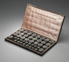 18th Century men's set of 26 jacket buttons and 18 smaller waistcoat buttons in the original silk and velvet presentation case.