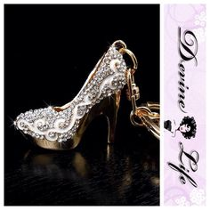 Crystal Bling Silver Stiletto Purse Charm/Keychain  Silver rhinestone stiletto high heel shoe keychain. Beautifully designed with gold tone metal, white enamel & detailed with sparkling silver Crystal bling. Includes a key ring and a secure lobster clasp, perfect for use as a keychain or purse charm.  Features: Chain Metal: Zinc Alloy Stone: Rhinestone Crystal Measurements: Charm: 1.5 in. x 1.5 in. Chain: 2.5 in. x 1.25 in. Total Measurements: 4 in. x 2 in.  Many available, contact me to buy…