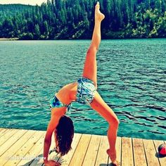 Location is everything. For instance, bodies of water add to the zen. | Let Us Learn From These Celebs Doing Upside Down Yoga on Instagram