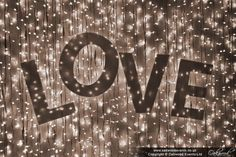 Love letters against a fairy light backdrop.