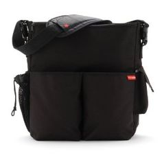 Plain and black, so my husband doesn't feel stupid carrying it. Plenty of pockets and storage. Big enough to hold what we need without being HUGE.