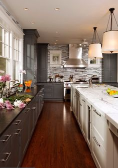 Narrow kitchen like the wall of windows and light and dark cabinets