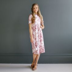 """Floral swing dress with short sleeves Approximate bust measurement: Small - 32"""" Medium - 34"""" Large - 36"""" Approximate length: All sizes - 44"""" Fabric content: Polyester, Spandex"""