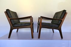 Pair of Rosewood and Leather Lounge Chairs by Ole Wanscher   From a unique collection of antique and modern lounge chairs at https://www.1stdibs.com/furniture/seating/lounge-chairs/